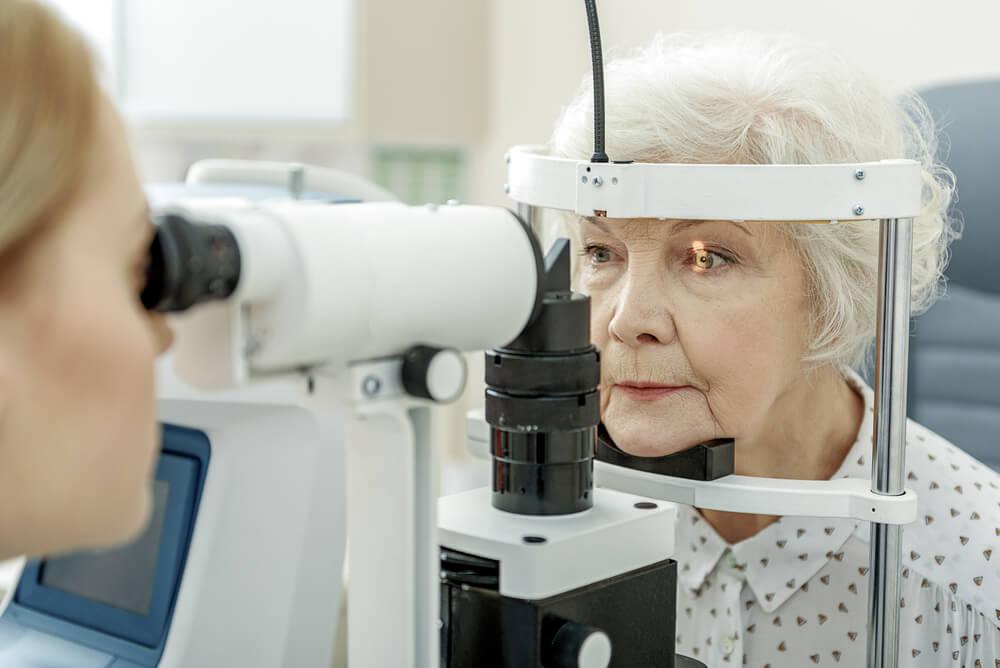 older female getting optometry visit for eye diseases