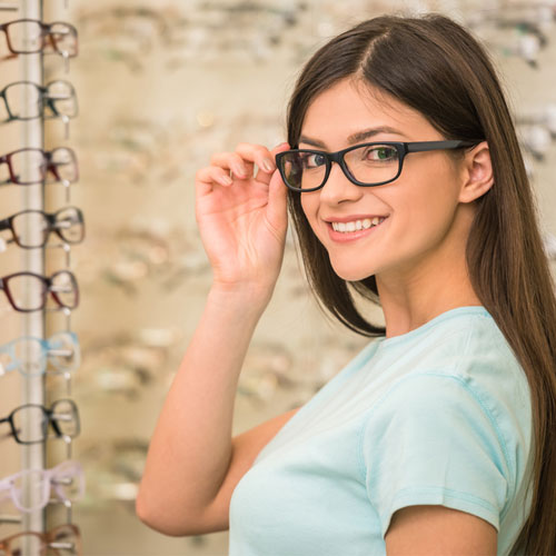 attractive female smiling with glasses