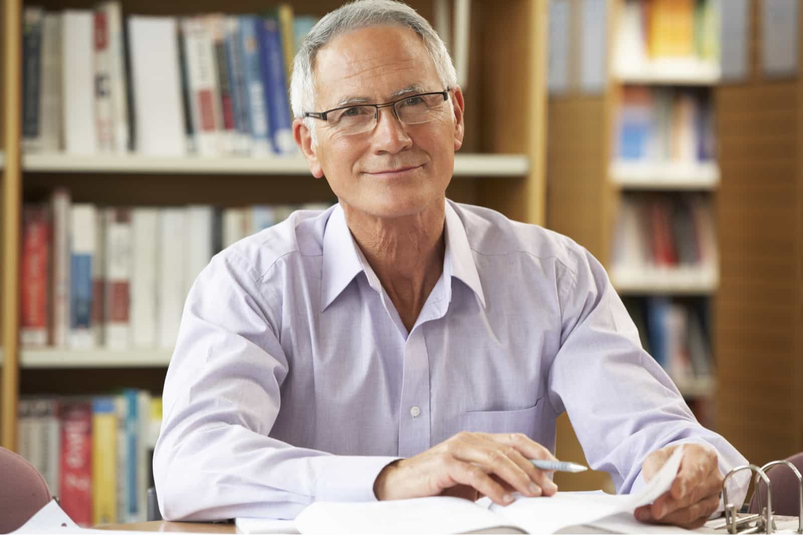 Smiling older male in library