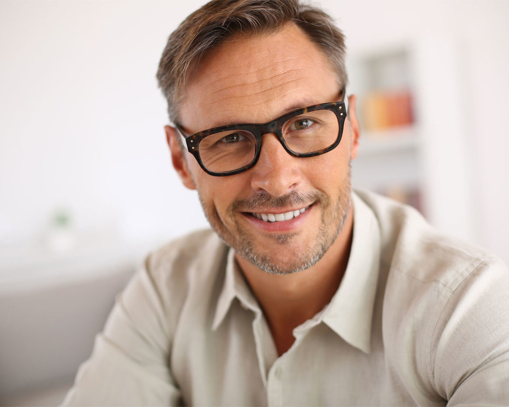 Male smiling with brand-new glasses