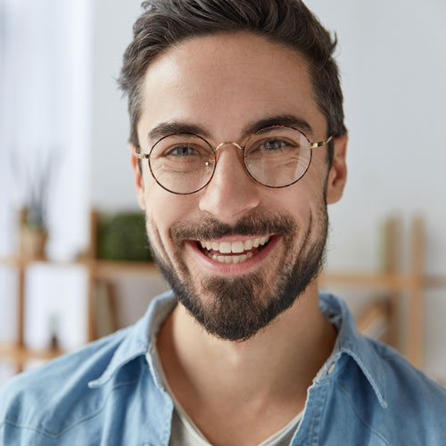 attractive male smiling with glasses