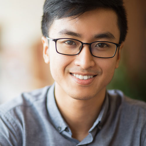 male smiling with glasses